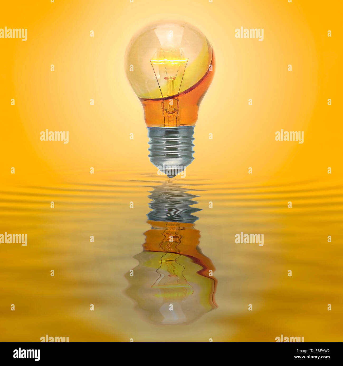 Enlighten bulb with no electrical connection filled with yellow water - Stock Image