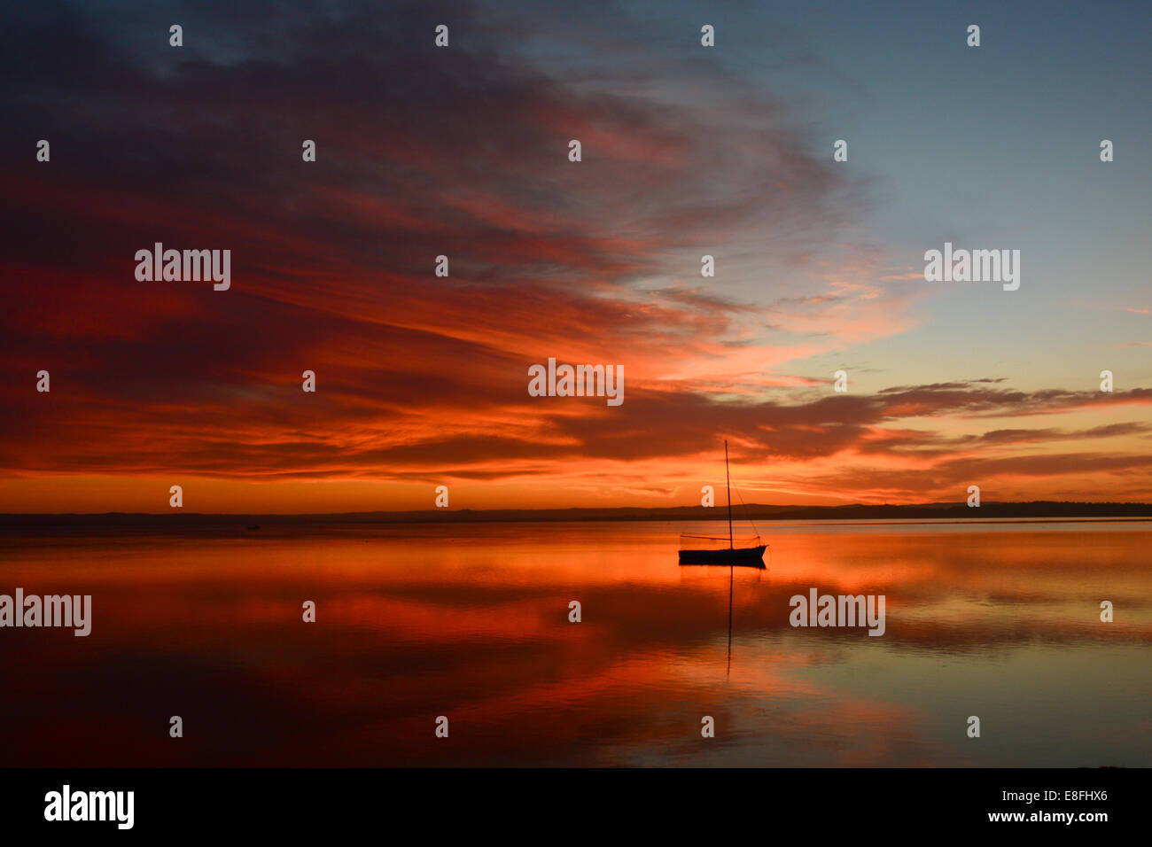 View of boat at sunset - Stock Image