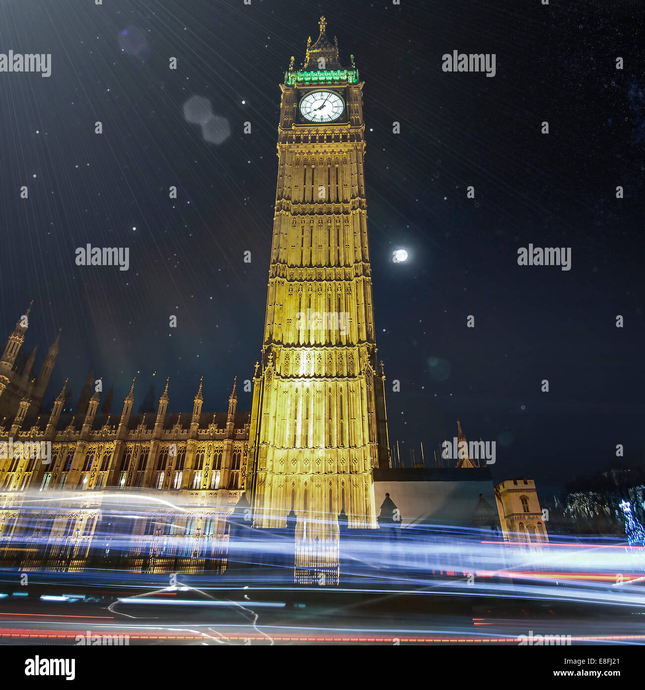 Big Ben at night with light trails, London, England, UK - Stock Image