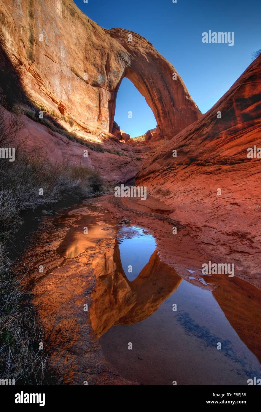 USA, Utah, Glen Canyon National Recreation Area, Reflection of Broken Bow Arch - Stock Image