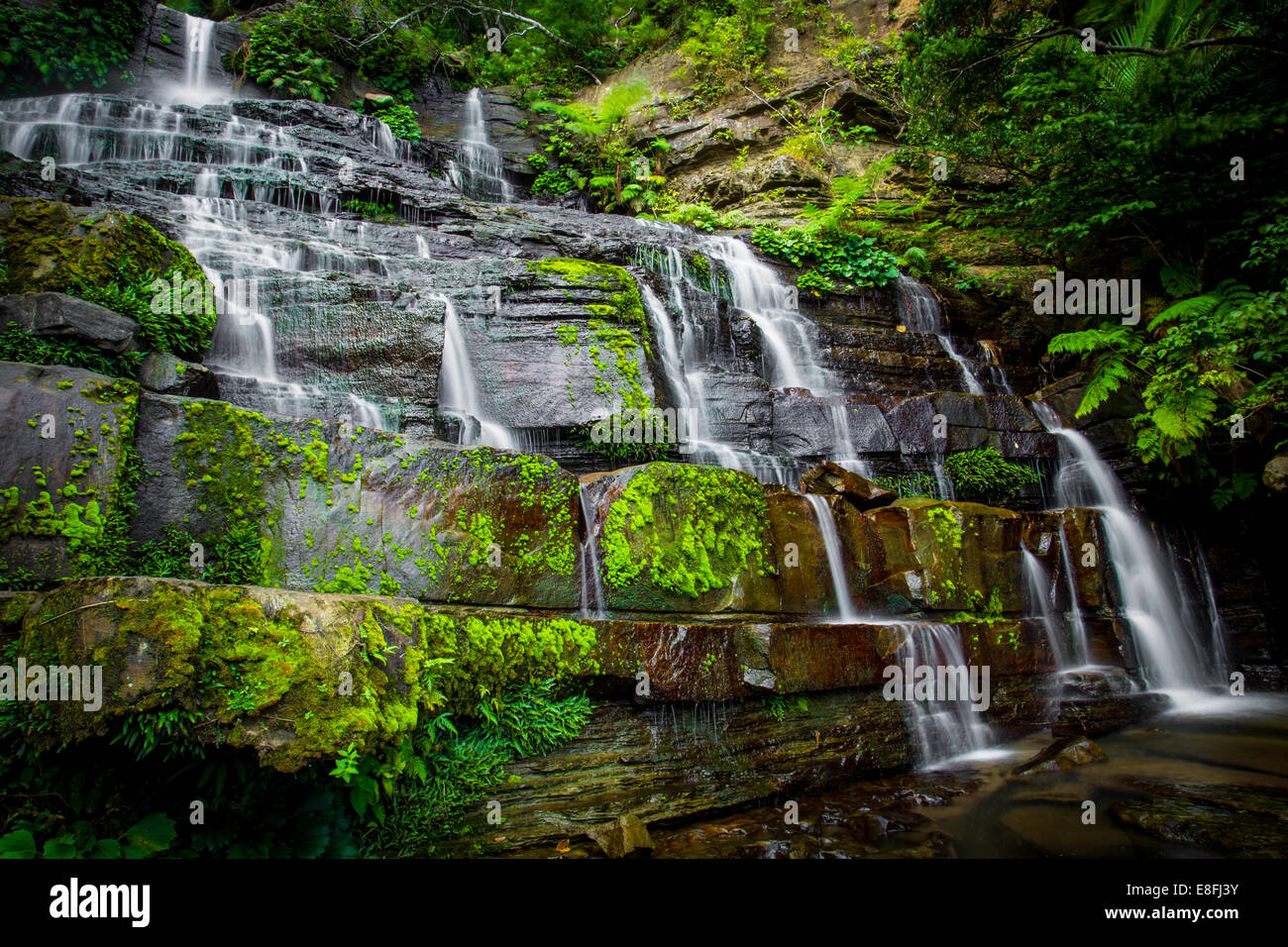 Waterfalls over rocks, Okinawa, Japan - Stock Image