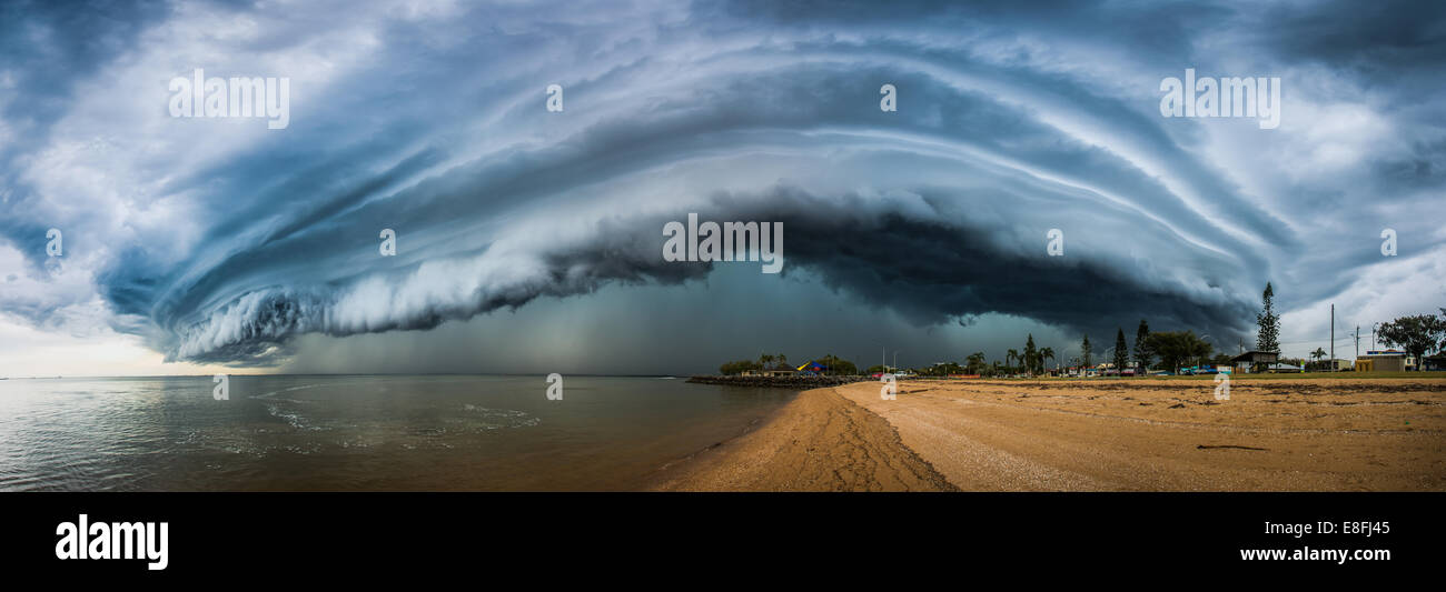 Storm cloud over beach, Redcliffe, Australia - Stock Image