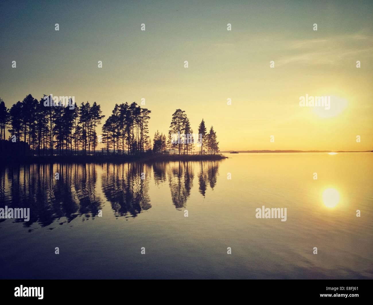 Sweden, Tallberg, Lake Siljan at sunset - Stock Image