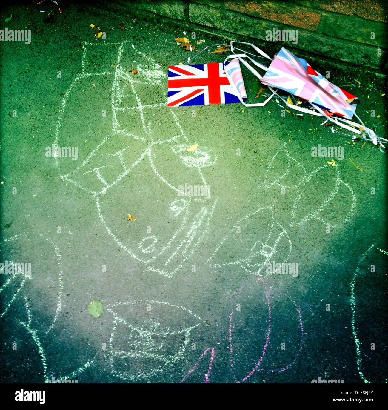 UK, England, London, Chalk drawings on sidewalk and bunting next to it Stock Photo