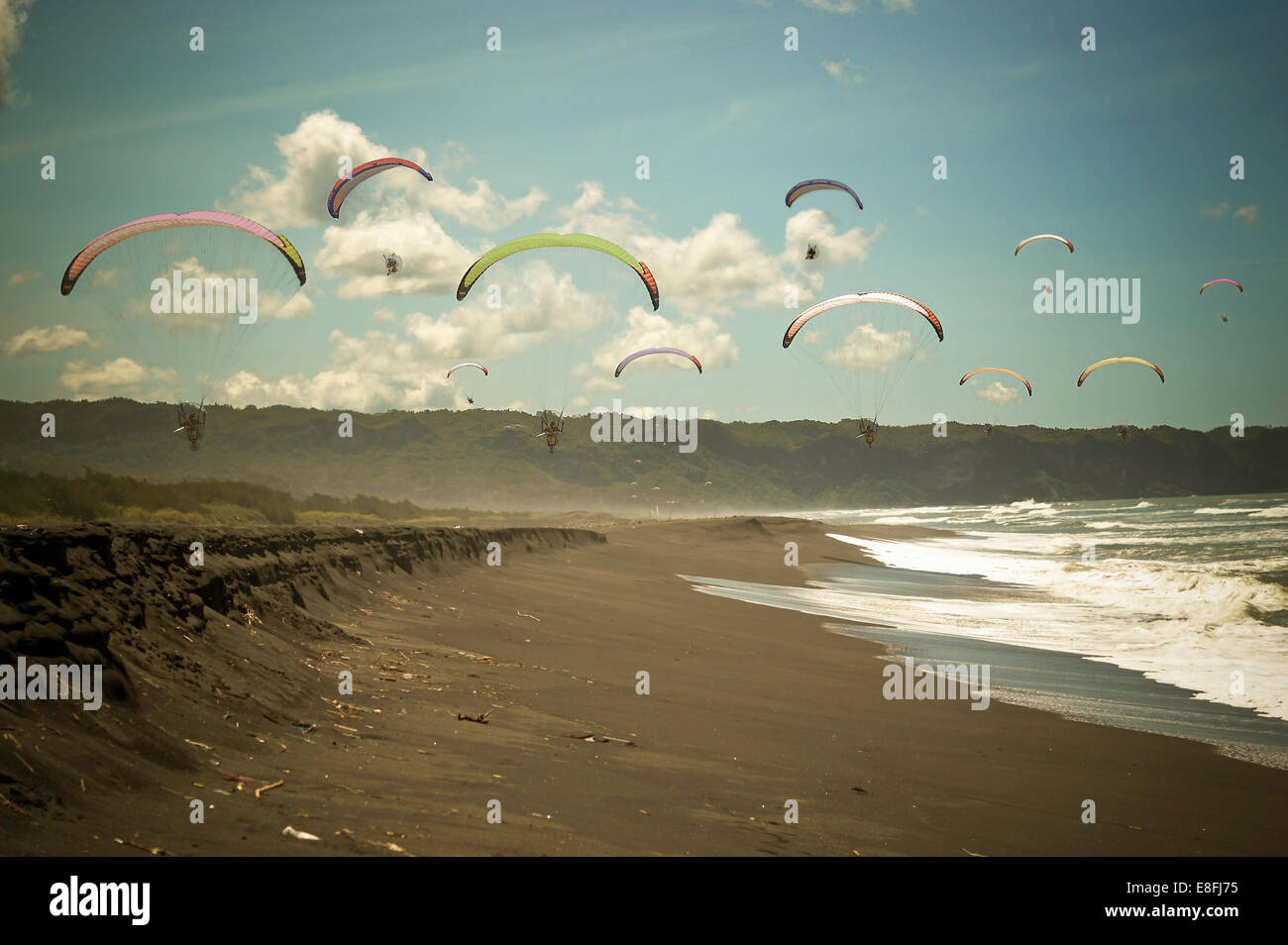 Indonesia, Yogyakarta Region, Jogja, Paragliding above Parang Tritis Beach - Stock Image