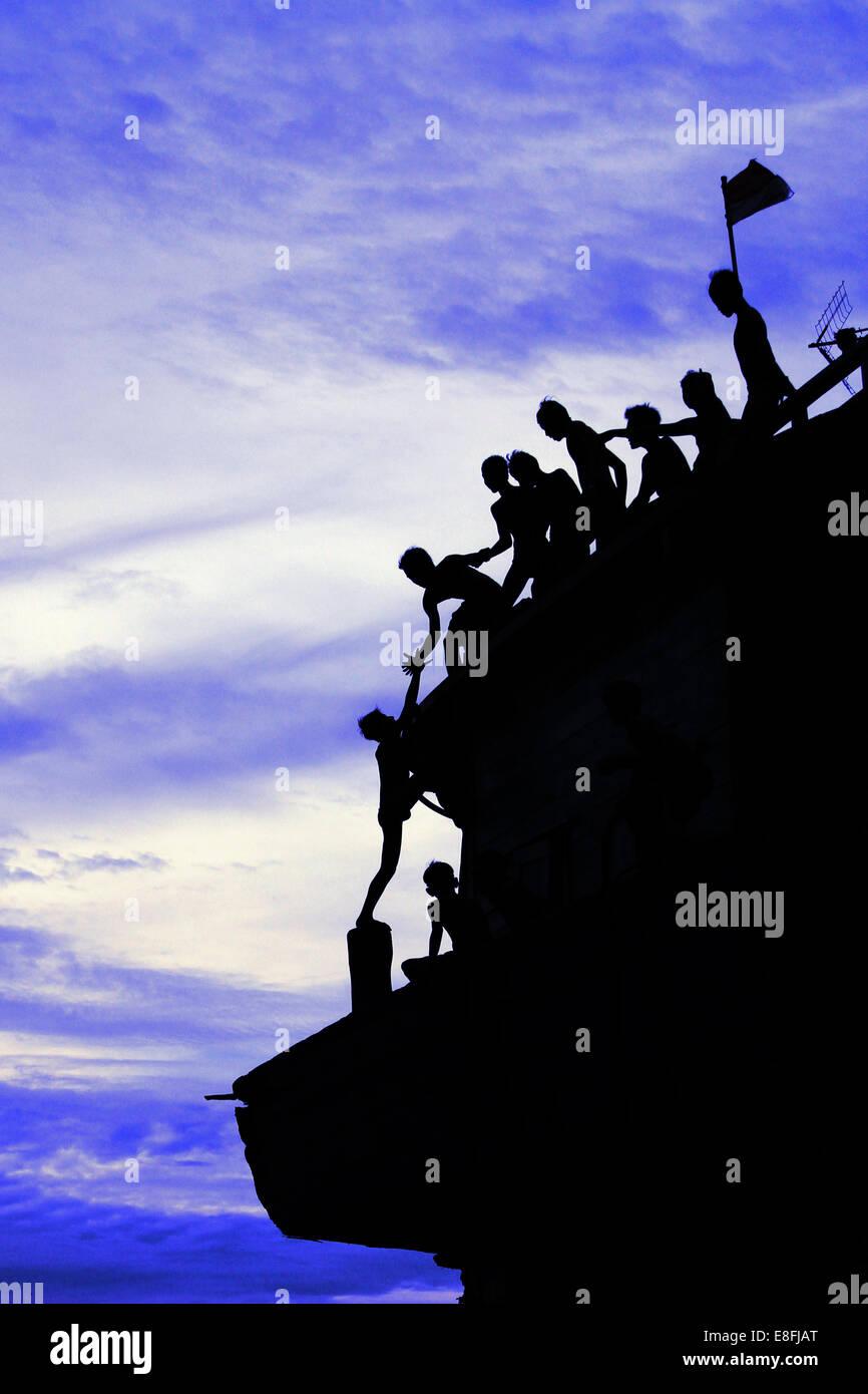 Indonesia, Jakarta Special Capital Region, Penjaringan, Maritim Raya, Teamwork in climbing up Sunda Kelapa - Stock Image