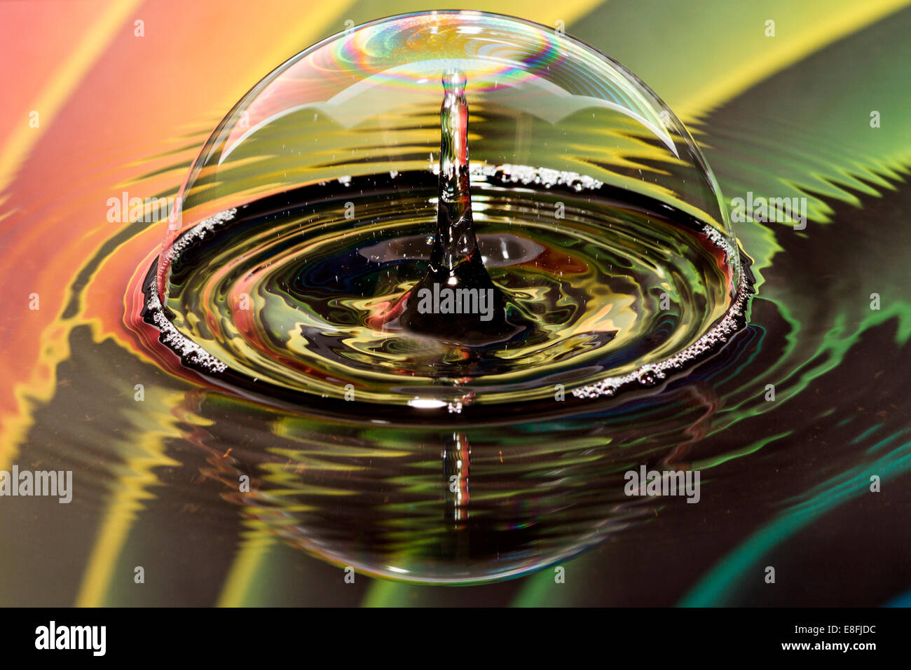 Water drops on bubble with rainbow background - Stock Image