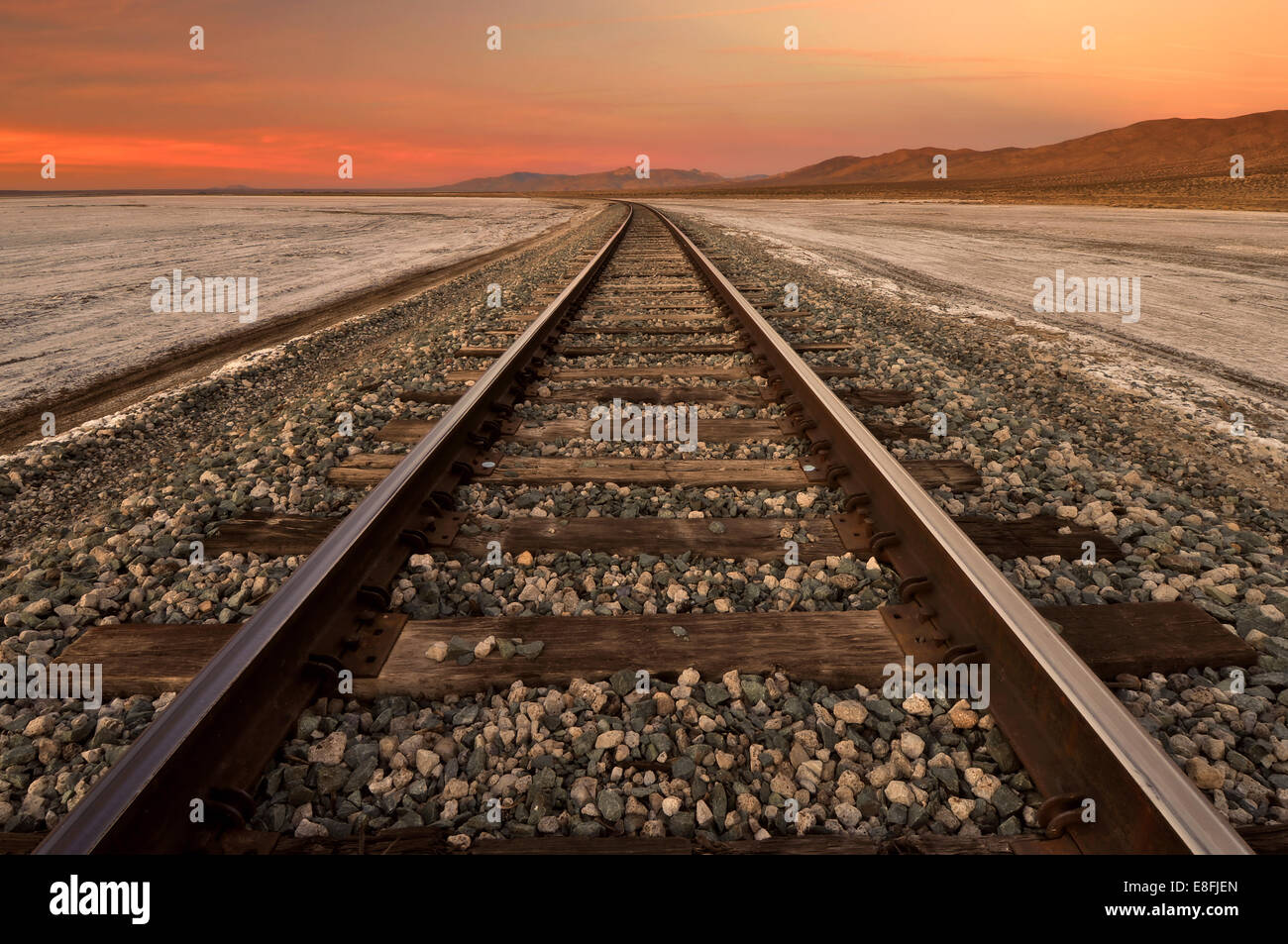 USA, California, Railroad Tracks Through Koehn Dry Lake on Mojave Desert - Stock Image
