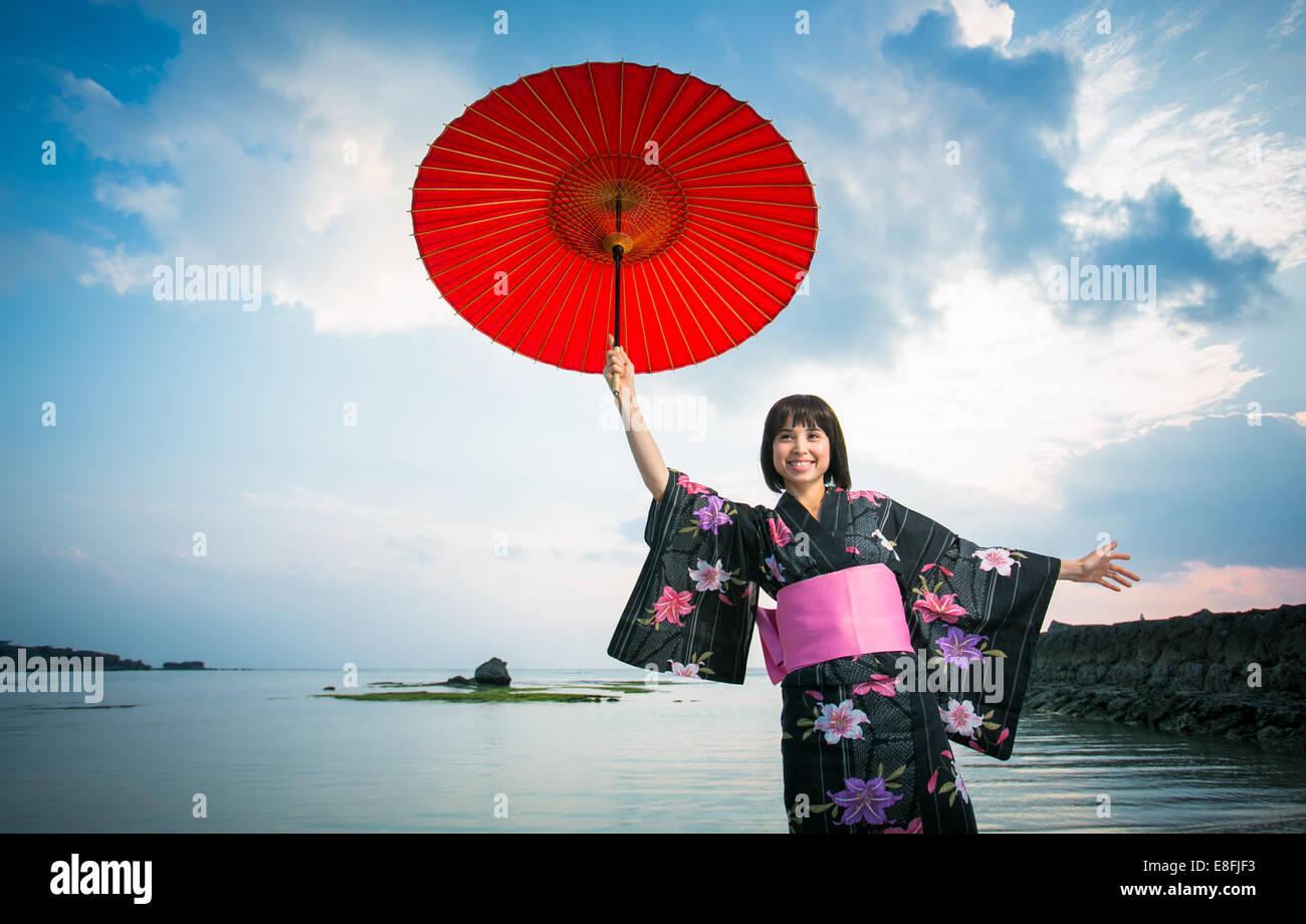 Japan, Okinawa, Happy Japanese woman in Kimono - Stock Image