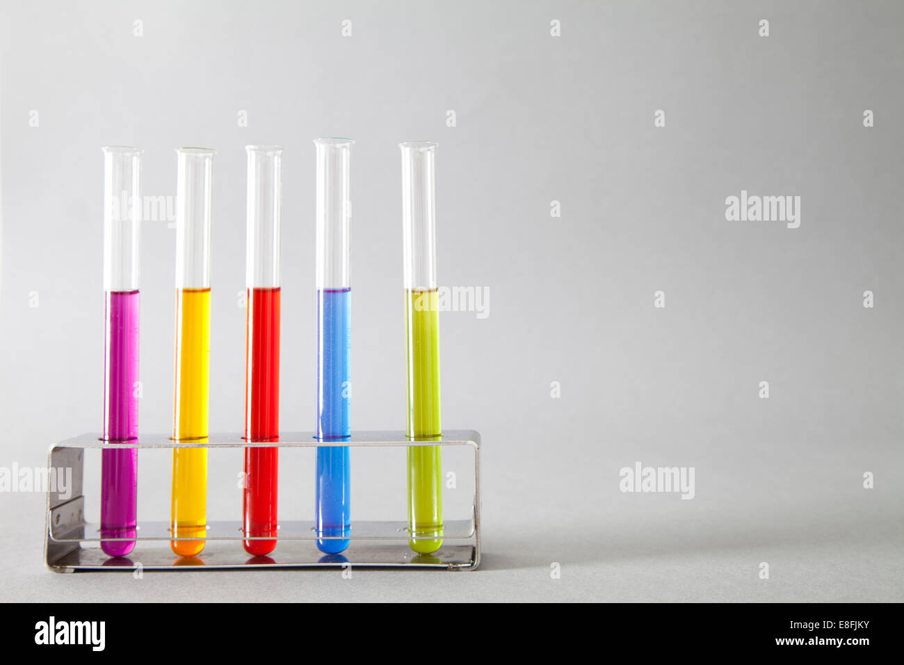 Colored liquids in test tubes - Stock Image