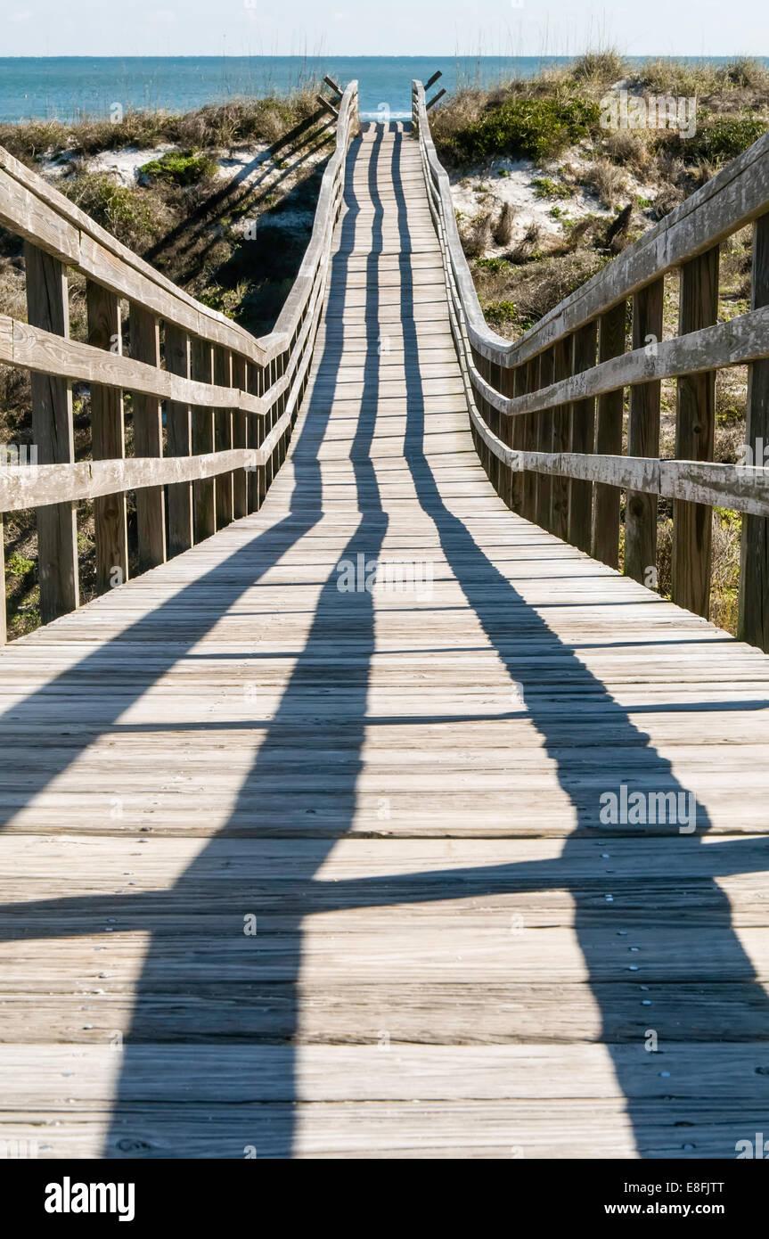 Boardwalk leading toward Atlantic Ocean - Stock Image