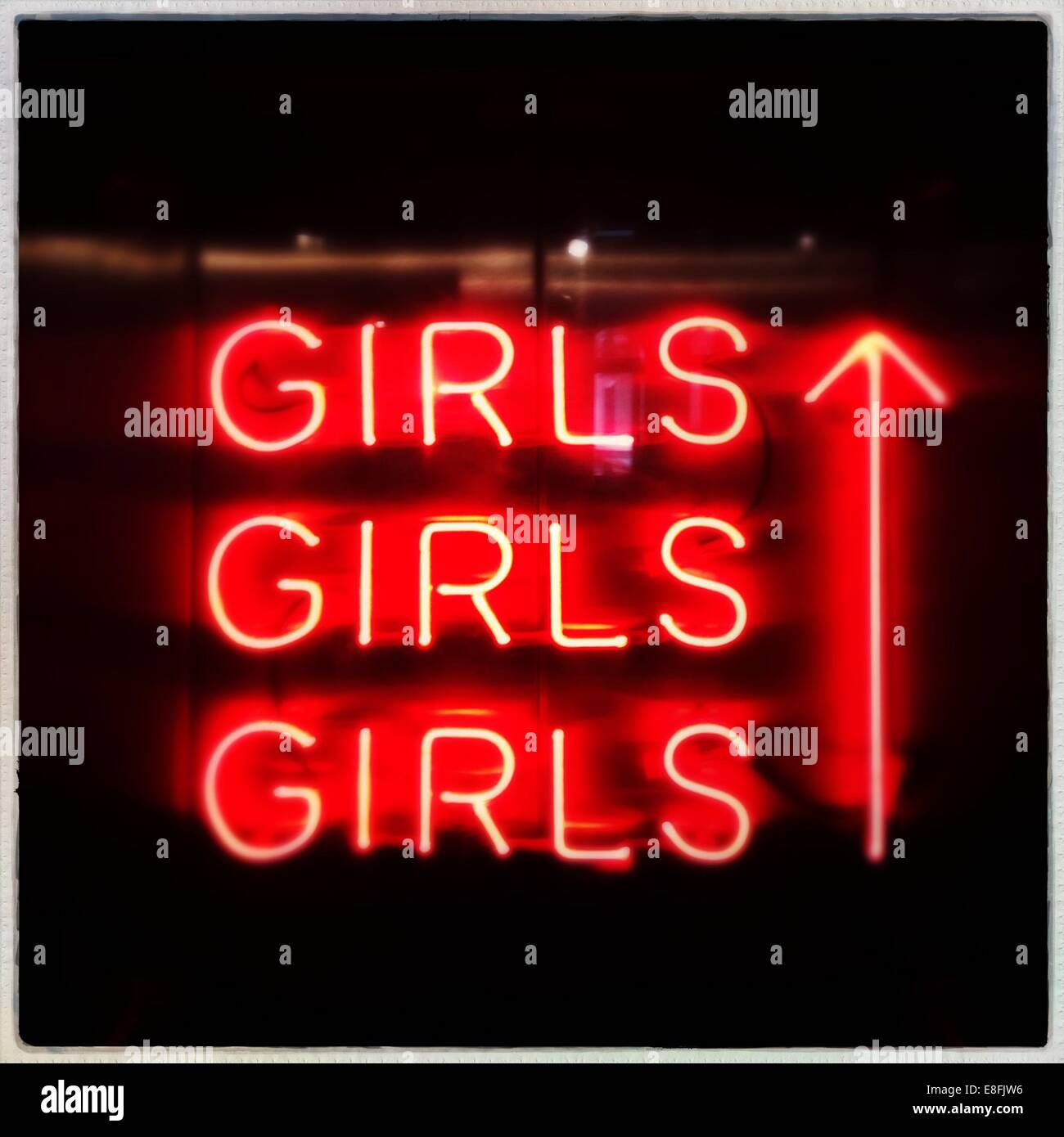 Netherlands, North Holland, Amsterdam, Orange neon 'girls' - Stock Image