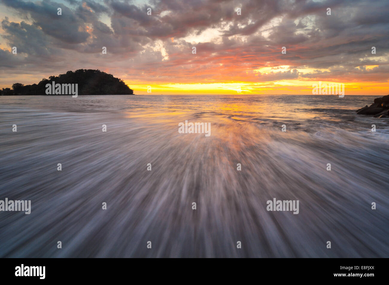 Indonesia, Padang, Taplau Beach, Wave and sunset - Stock Image
