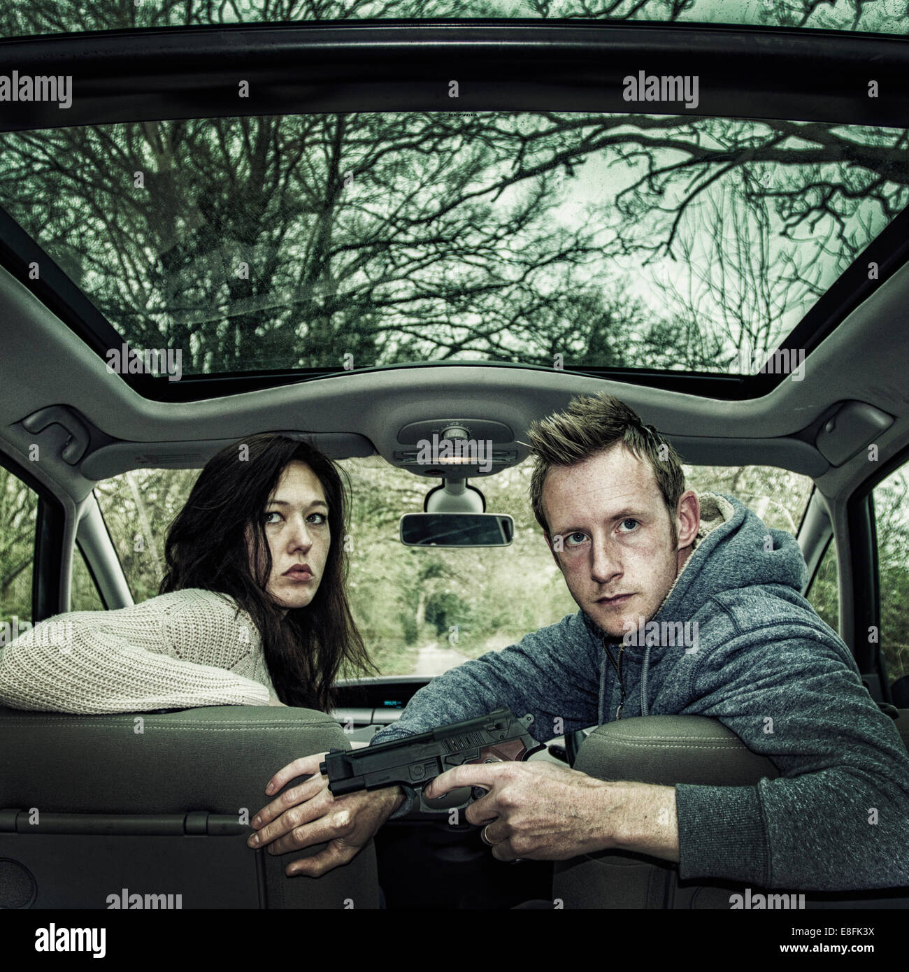 Man And Women in a car on the run, England, UK Stock Photo