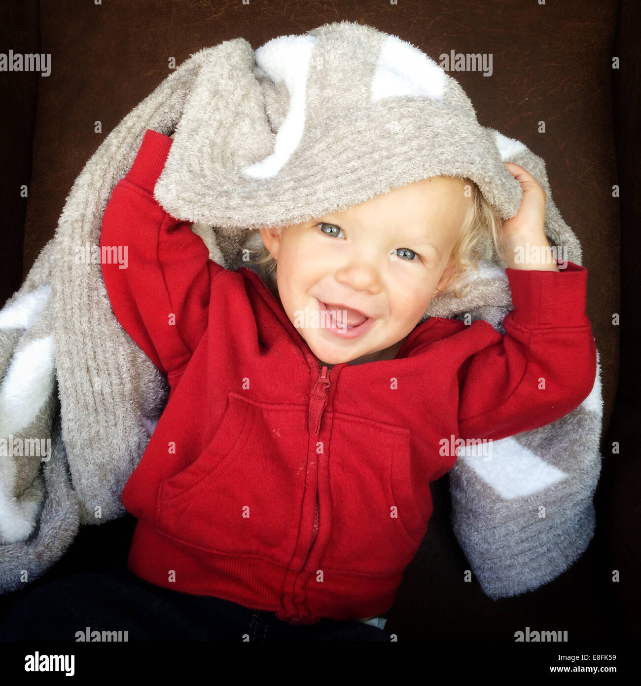 Portrait of a boy with a blanket on his head - Stock Image