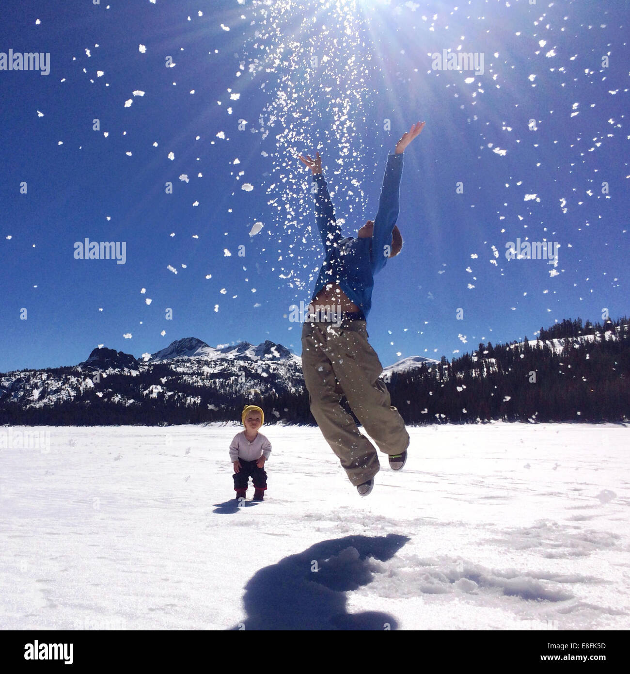 Two boys playing in the snow, Lake Tahoe, California, America, USA - Stock Image