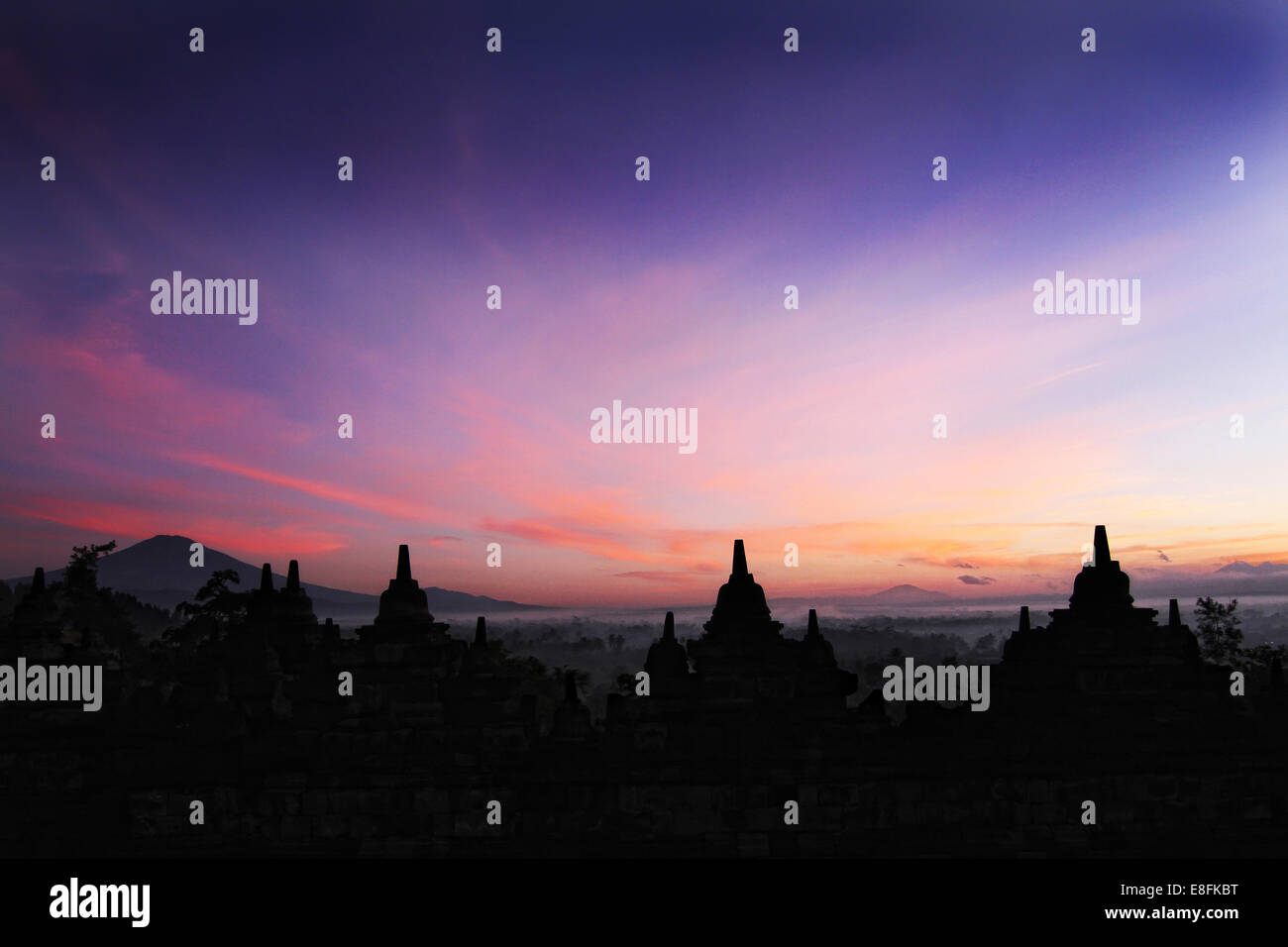 Indonesia, Java, Magelang, Silhouette of Borobudur Temple, 9th century - Stock Image