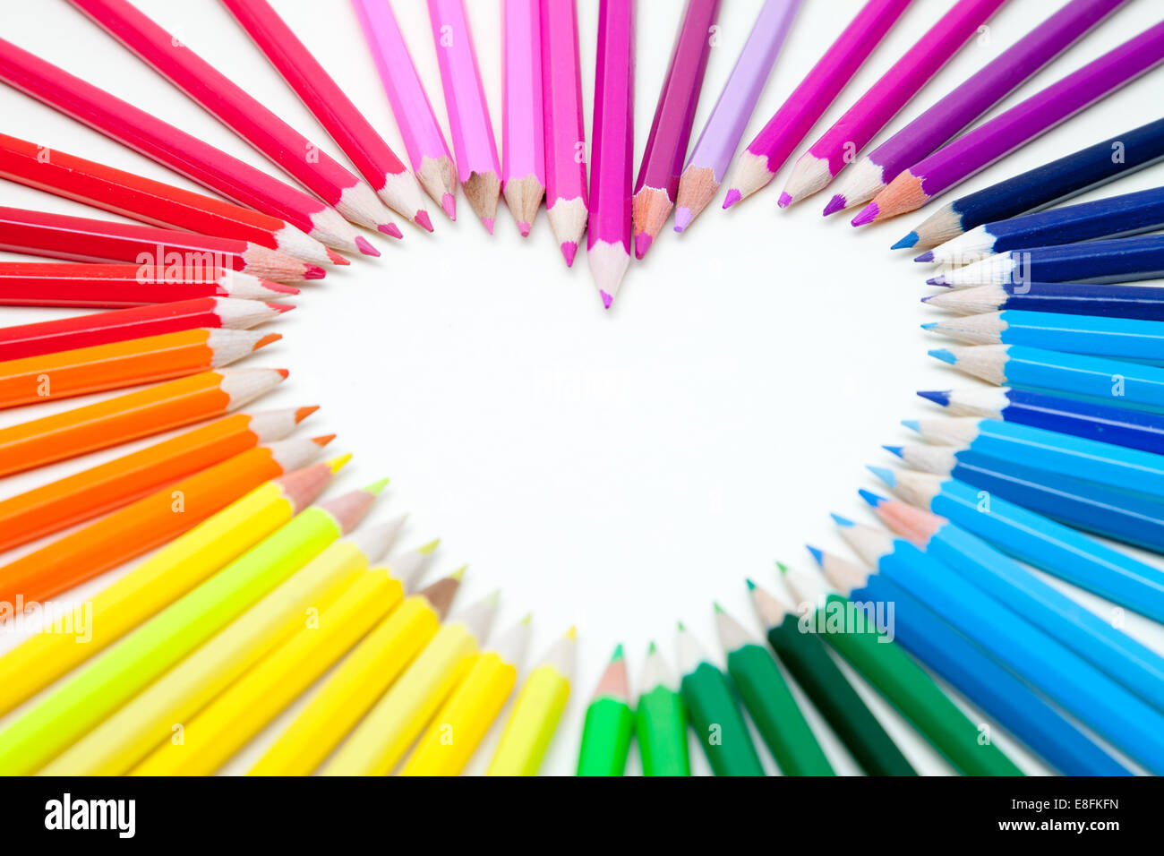 Pencils arranged in a heart shape - Stock Image