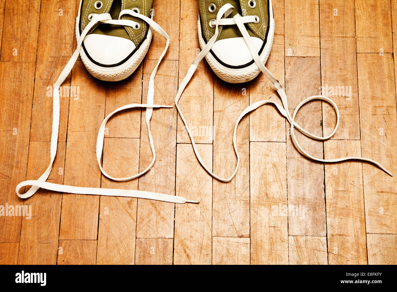 Shoelaces spelling the word love - Stock Image