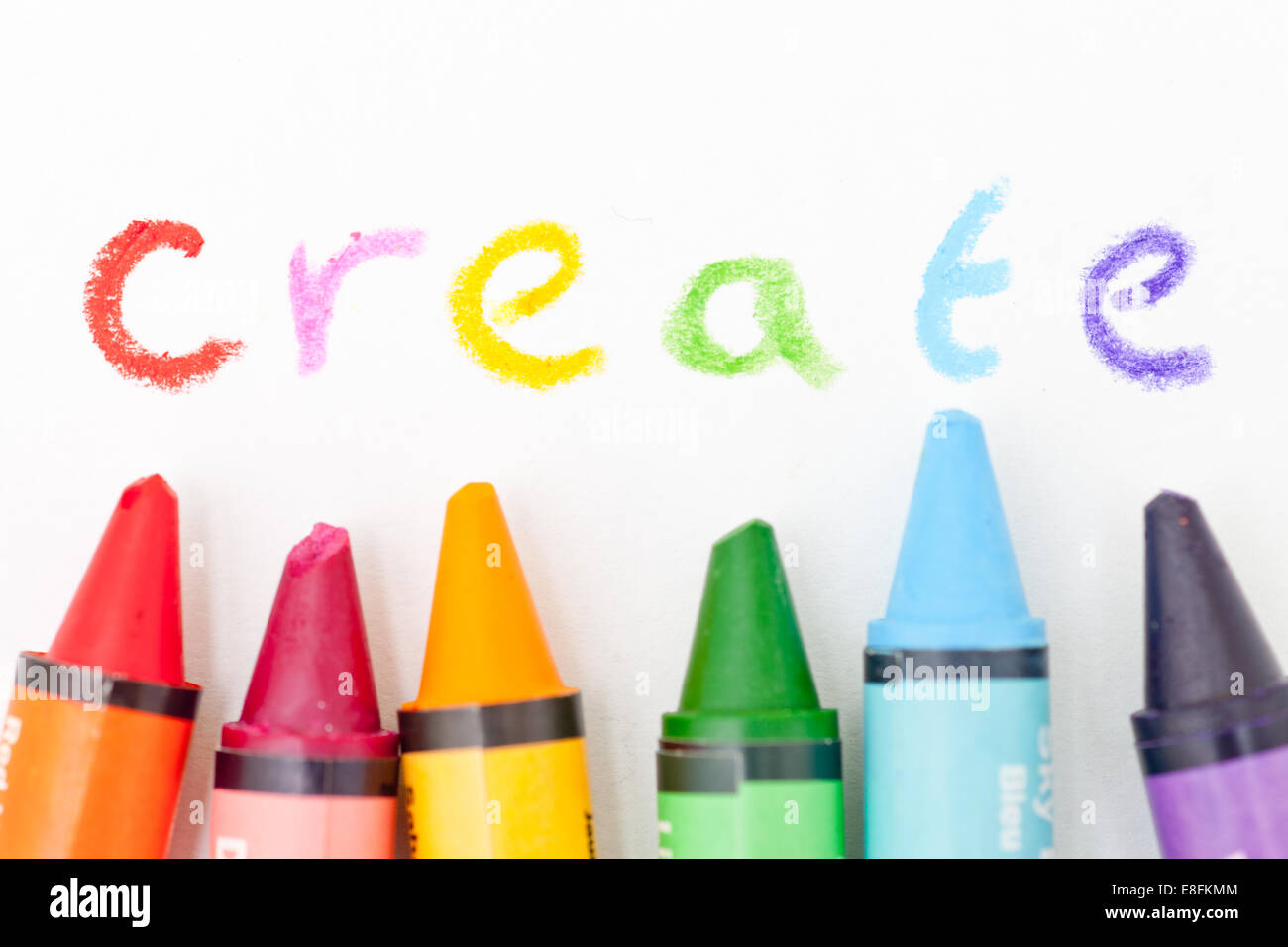 Colored crayons spelling word create - Stock Image
