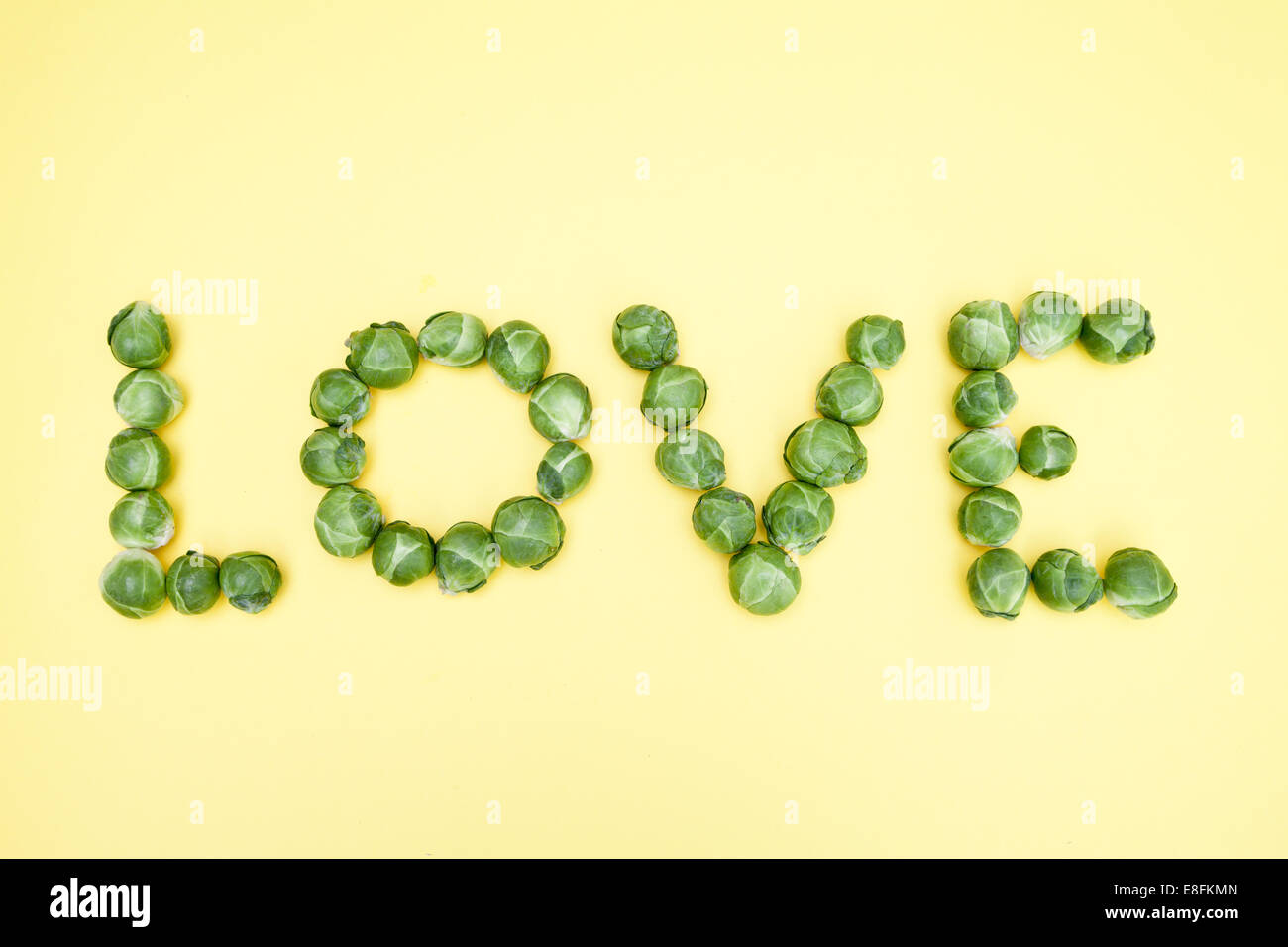 Brussels Sprouts Spelling Out Love - Stock Image
