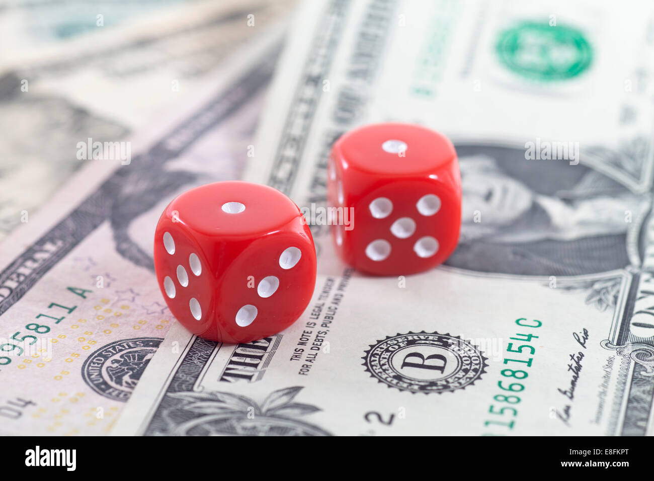 Pair Of Dice On Us Dollars - Stock Image