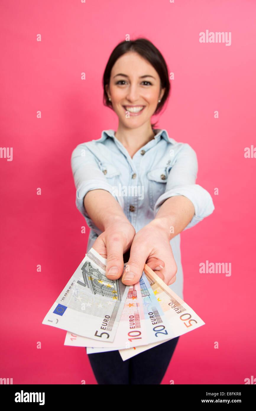 Woman Holding Euro Notes Stock Photo