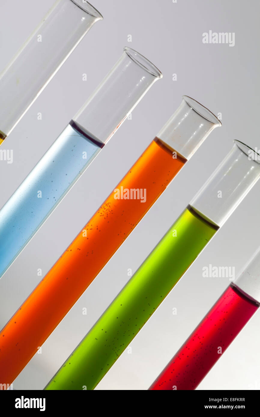 Coloured Liquids In Test Tubes - Stock Image