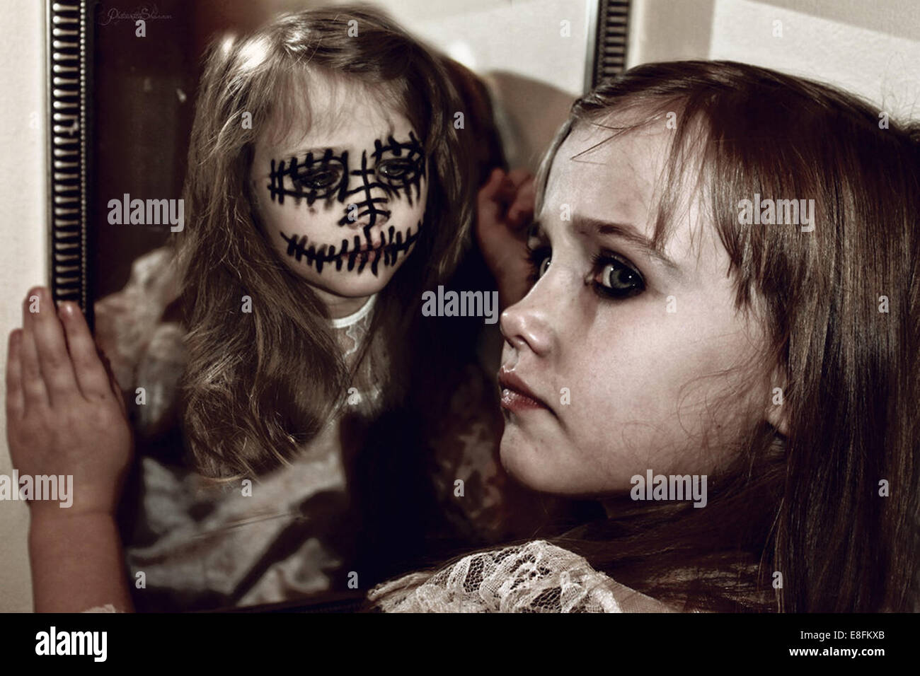 Girl and her alter ego in mirror - Stock Image
