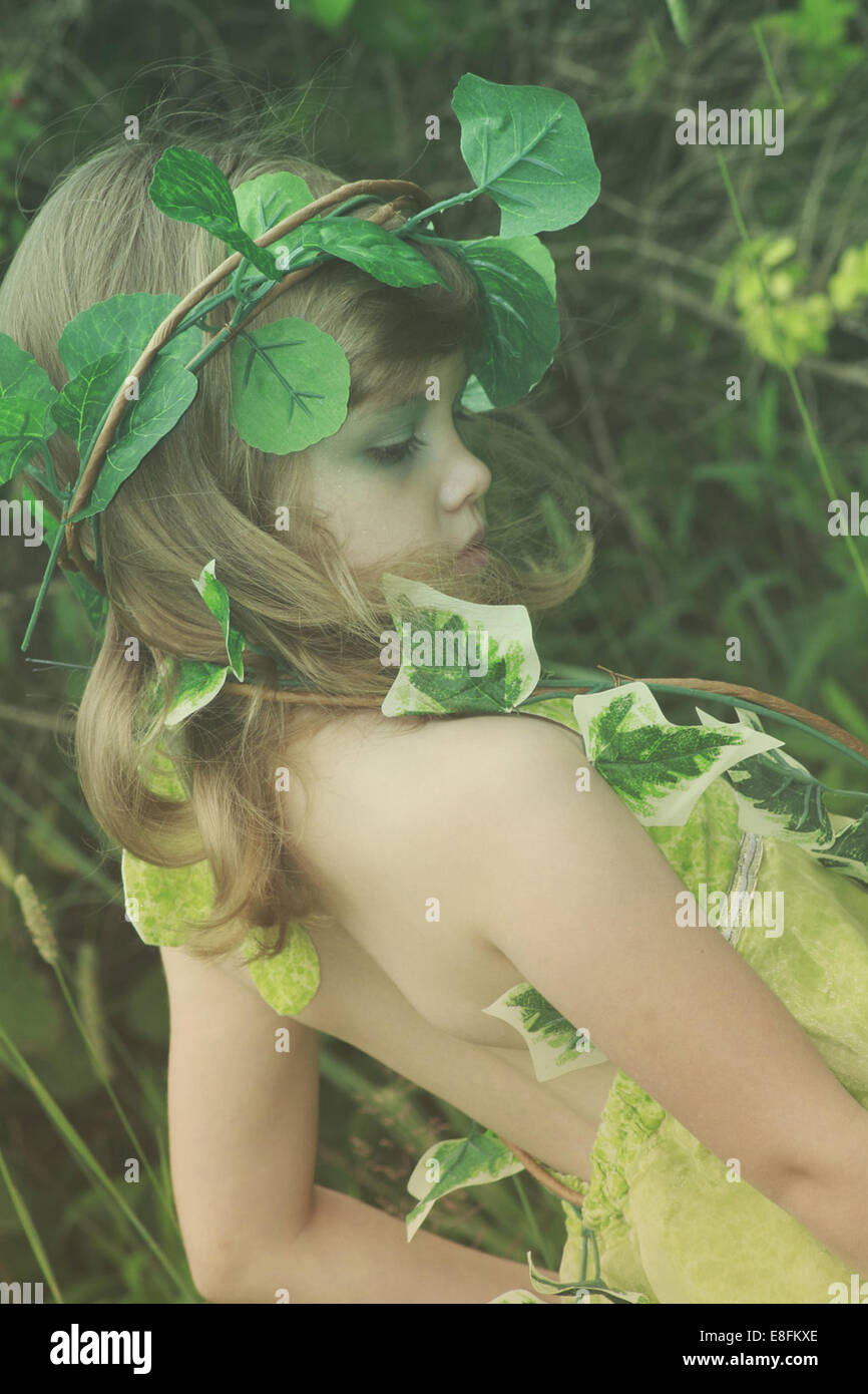 Girl dressed as tree fairy - Stock Image