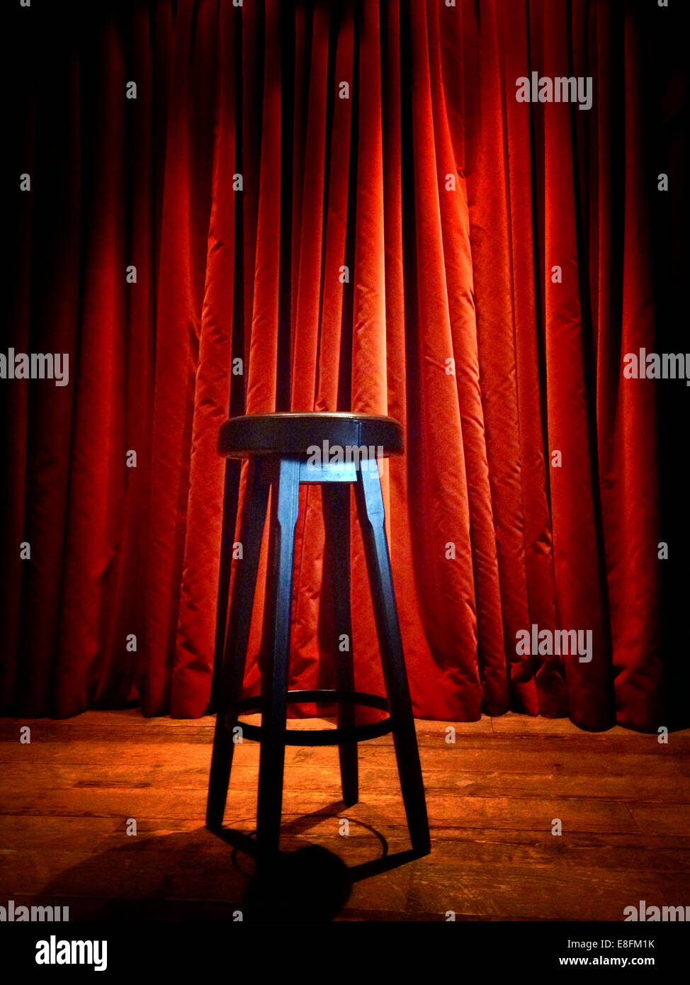 USA, California, Napa County, Napa, Stool on stage in front of red curtain - Stock Image