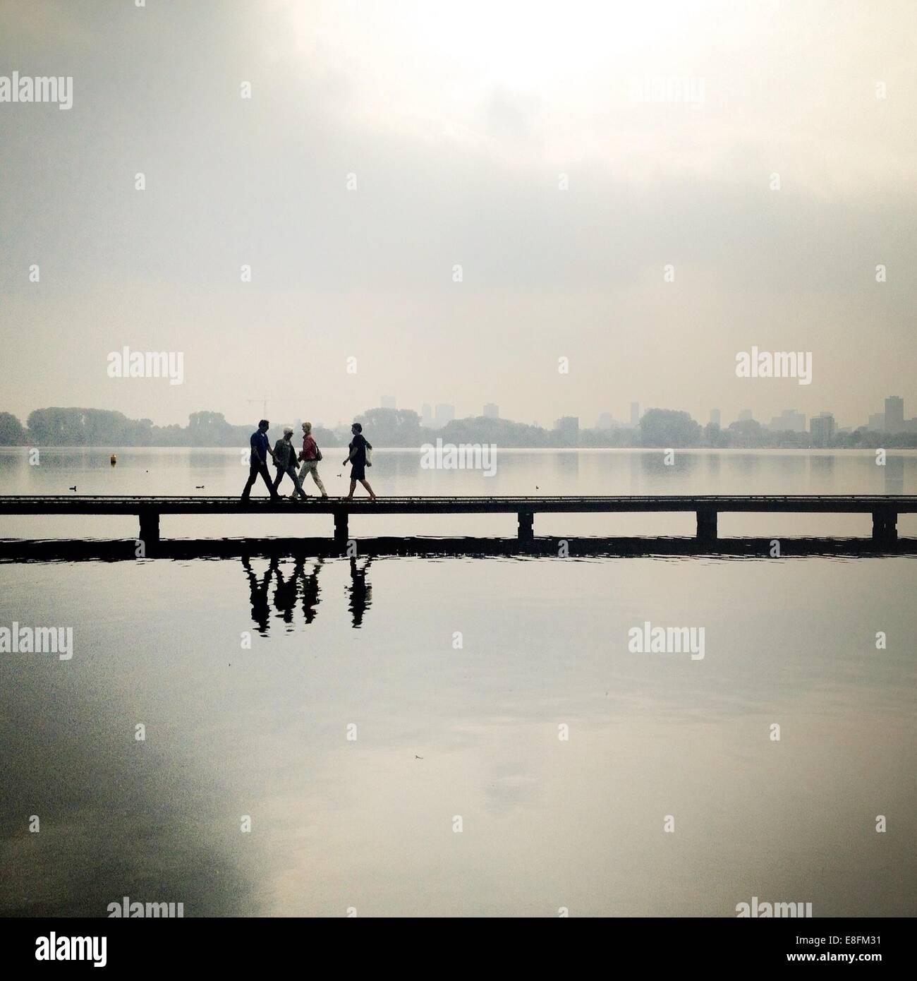 Nederland, Rotterdam, Kralingse Plas, People crossing footbridge - Stock Image