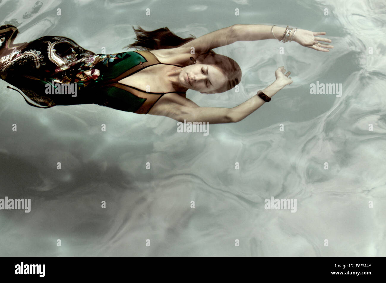 Woman In A Dress Underwater - Stock Image