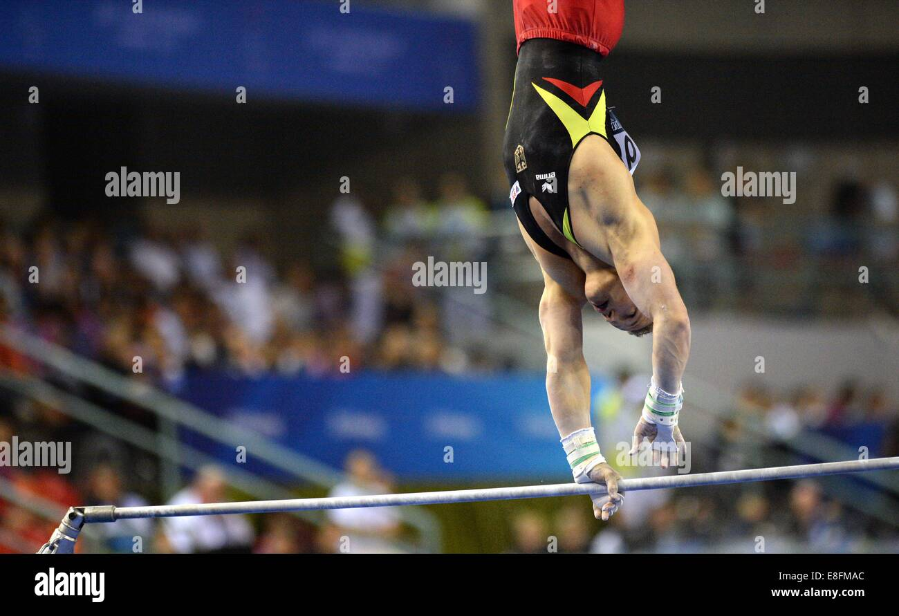 Nanning, China's Guangxi Zhuang Autonomous Region. 7th Oct, 2014. German gymnast Fabian Hambuechen performs - Stock Image