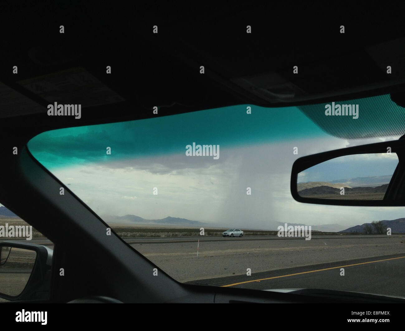 USA, Nevada, Storm seen from car interior - Stock Image