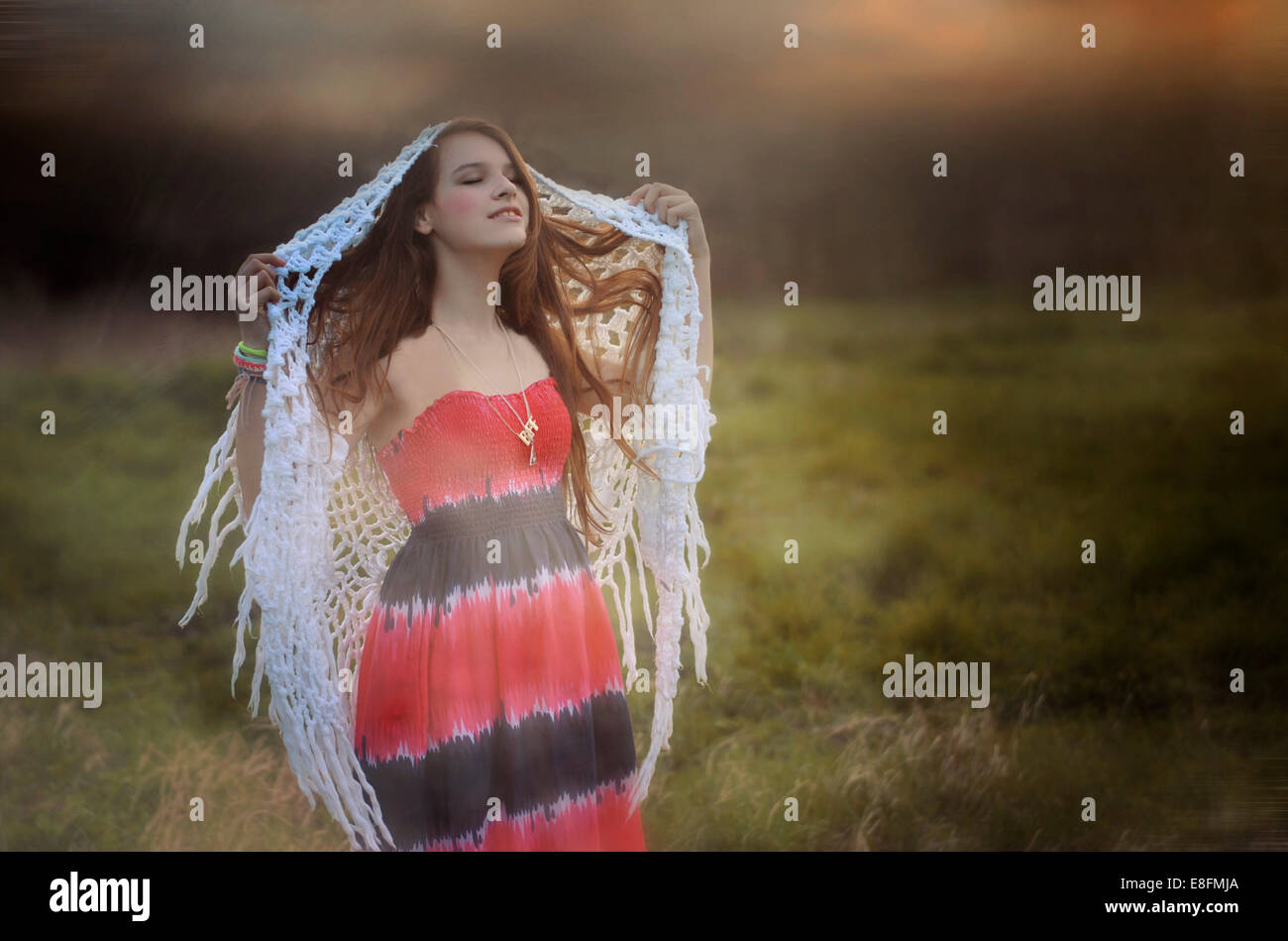 Woman walking and dreaming on misty meadow - Stock Image