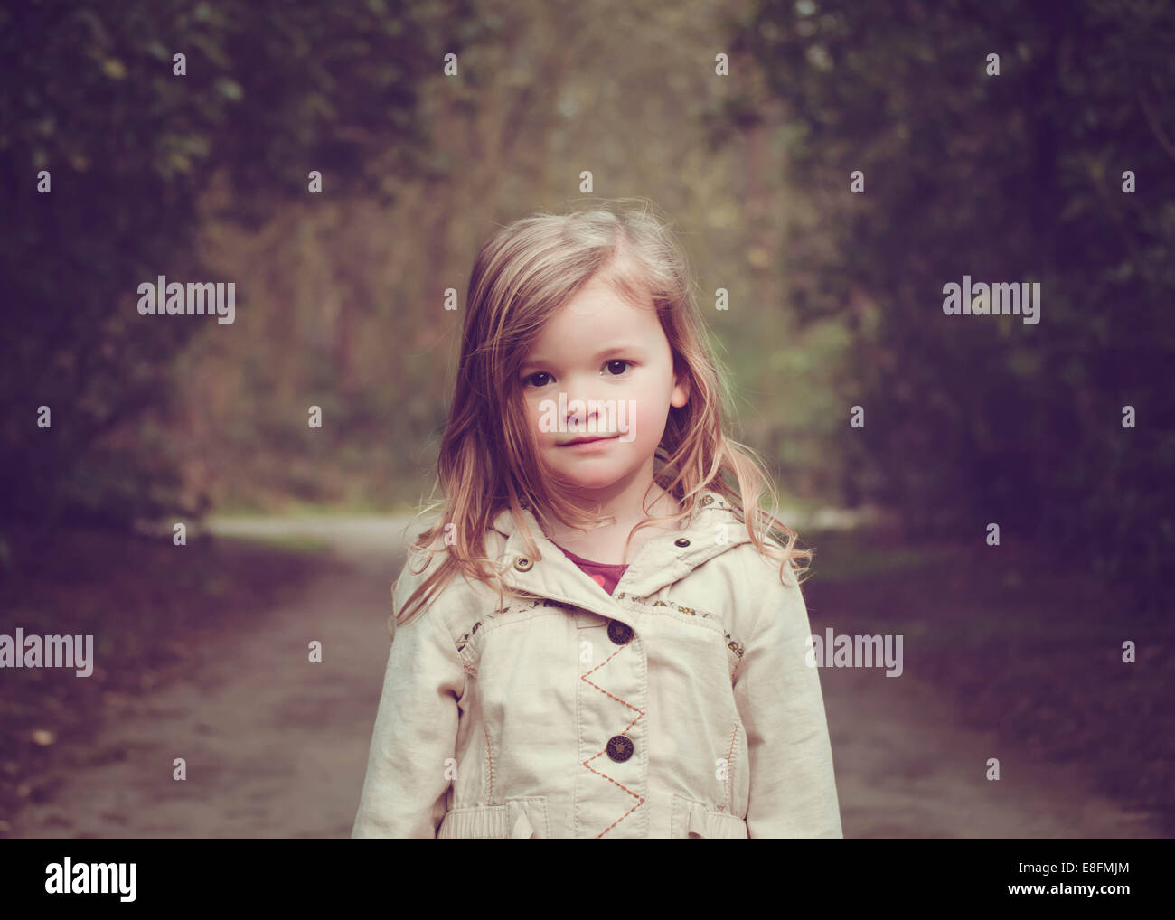 Girl (2-3) standing in park - Stock Image