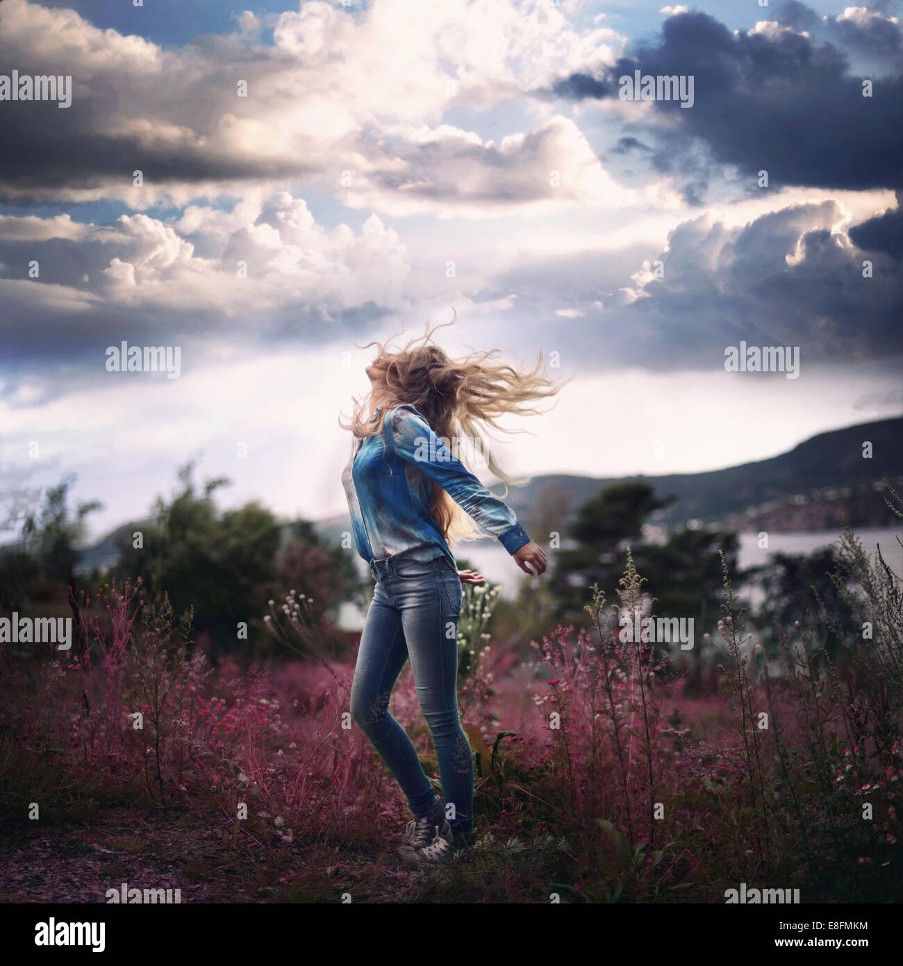 Woman Looking To The Sky - Stock Image