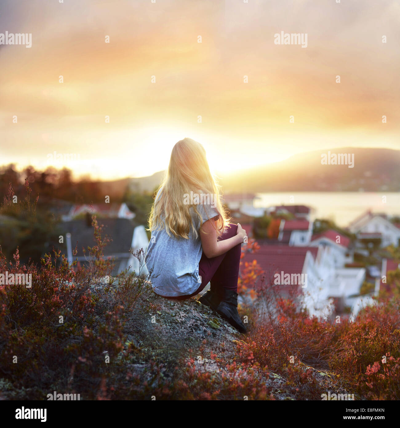 Woman Sitting On A Rock - Stock Image