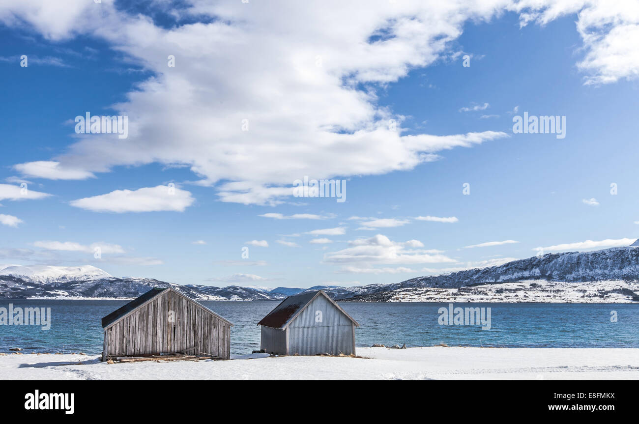 Norway, Vesteralen, Godfjord, Boathouses at shore - Stock Image