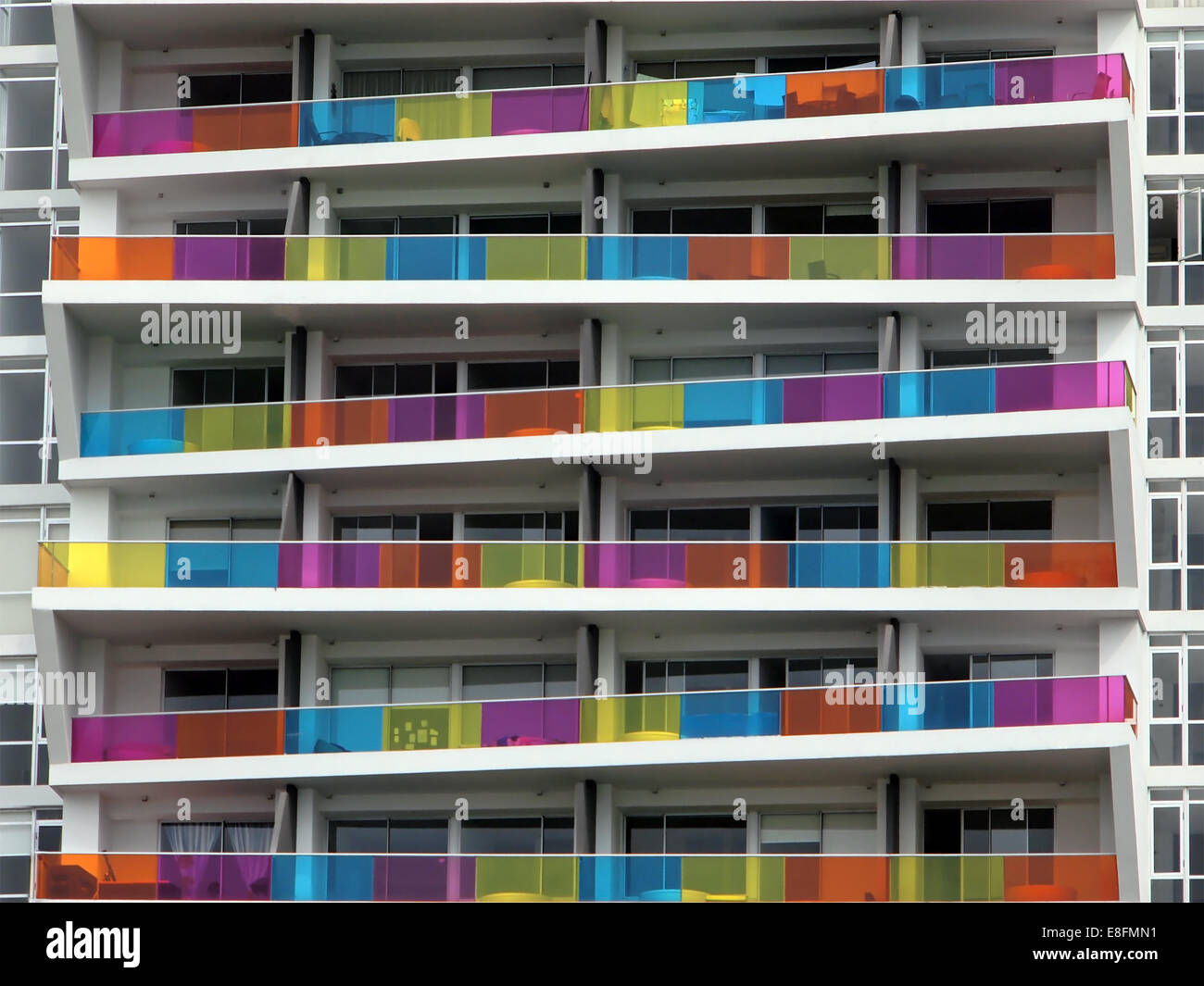 Apartment building with colorful balcony - Stock Image