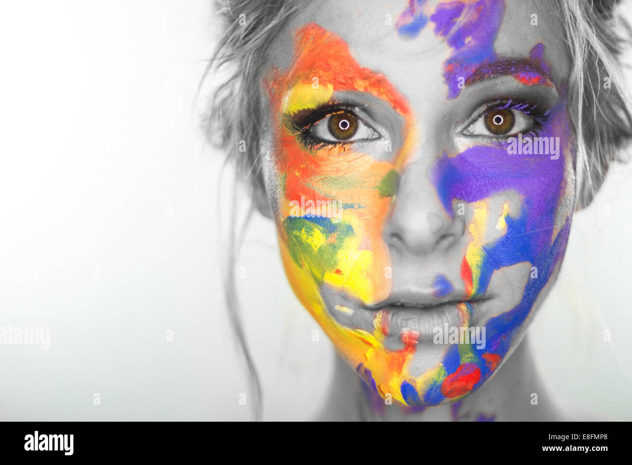 Studio shot of woman's head with painted face - Stock Image