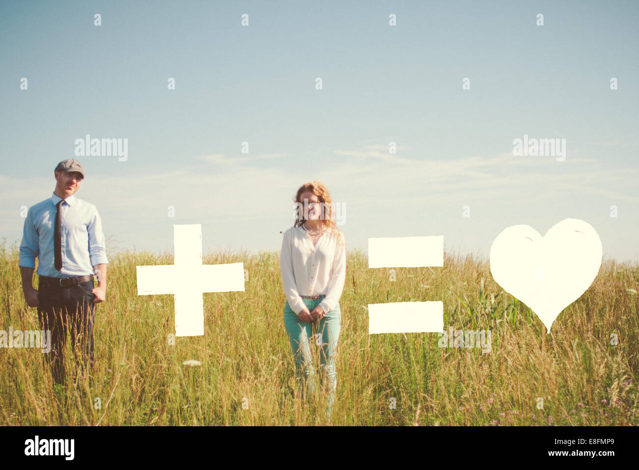 USA, Tennessee, Davidson County, Nashville, Couple and love equation on meadow - Stock Image
