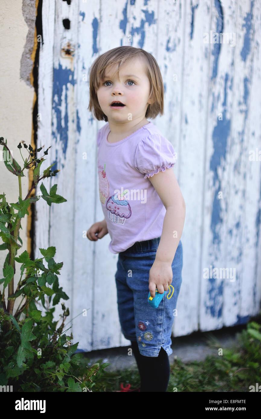 Little girl (4-5) in garden - Stock Image