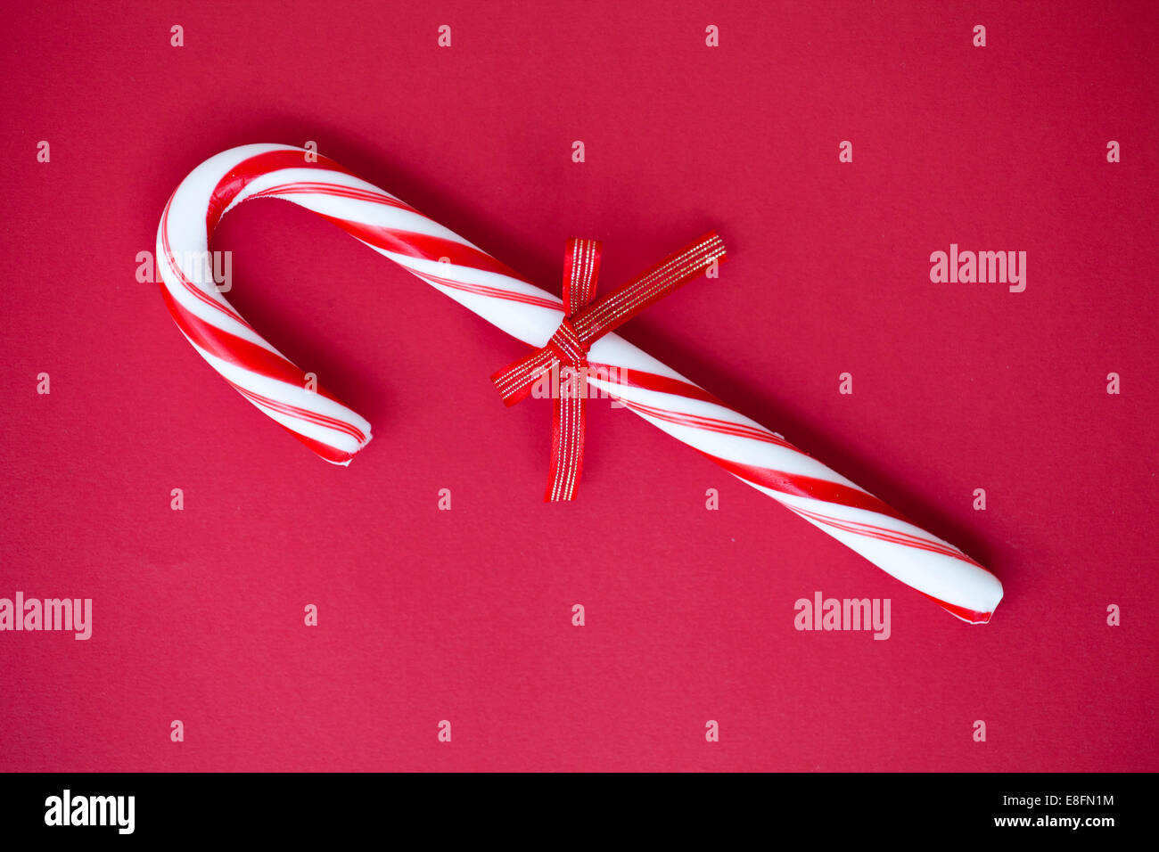 Candy Cane with a tied bow - Stock Image
