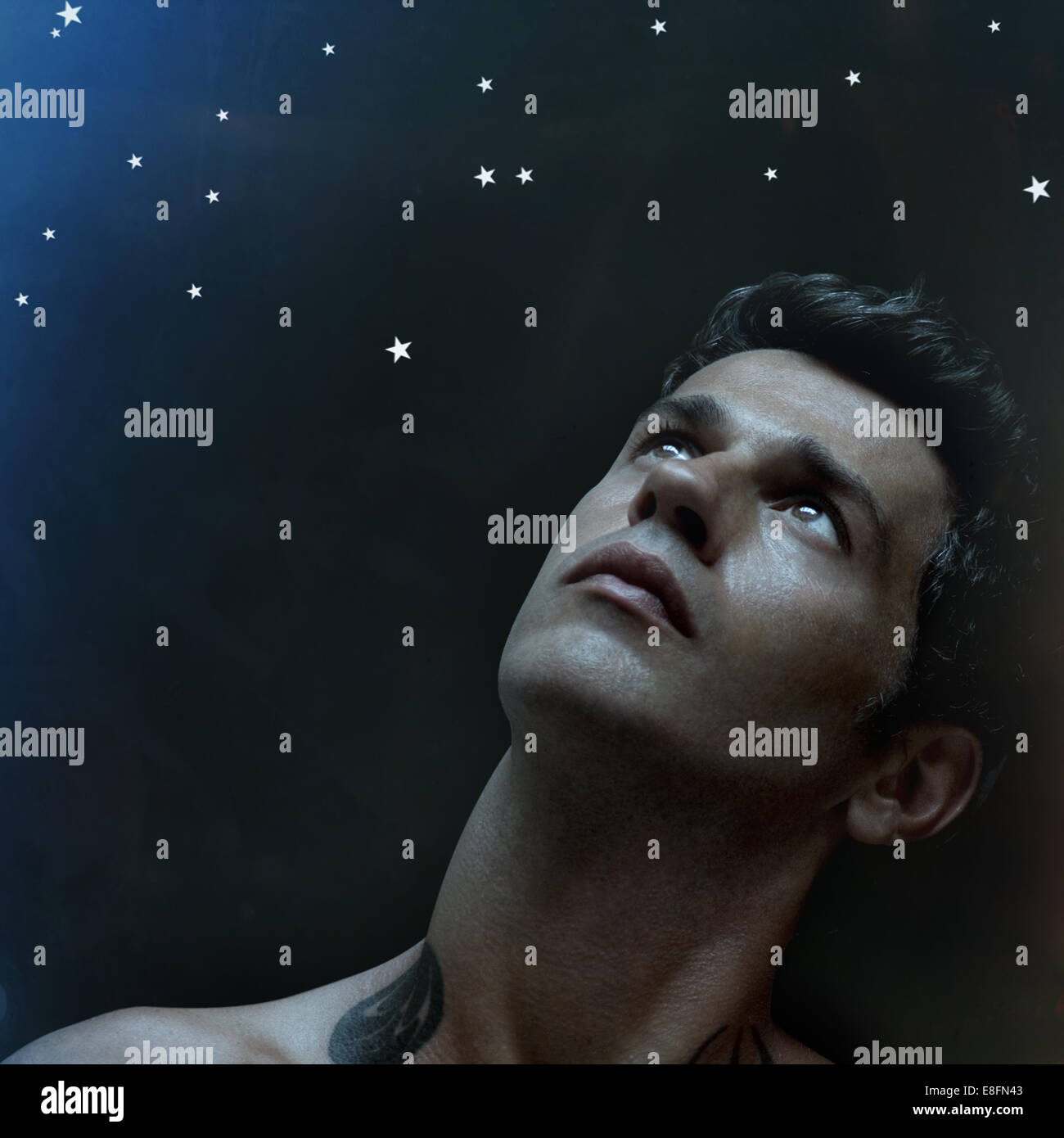 Portrait of man looking at the stars - Stock Image