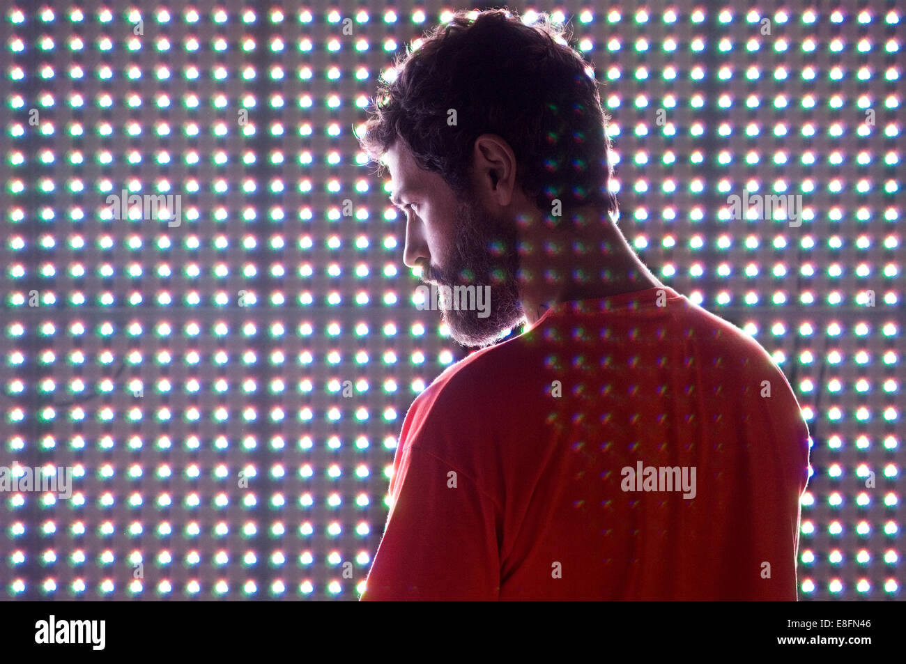 Man standing in front of led screen - Stock Image