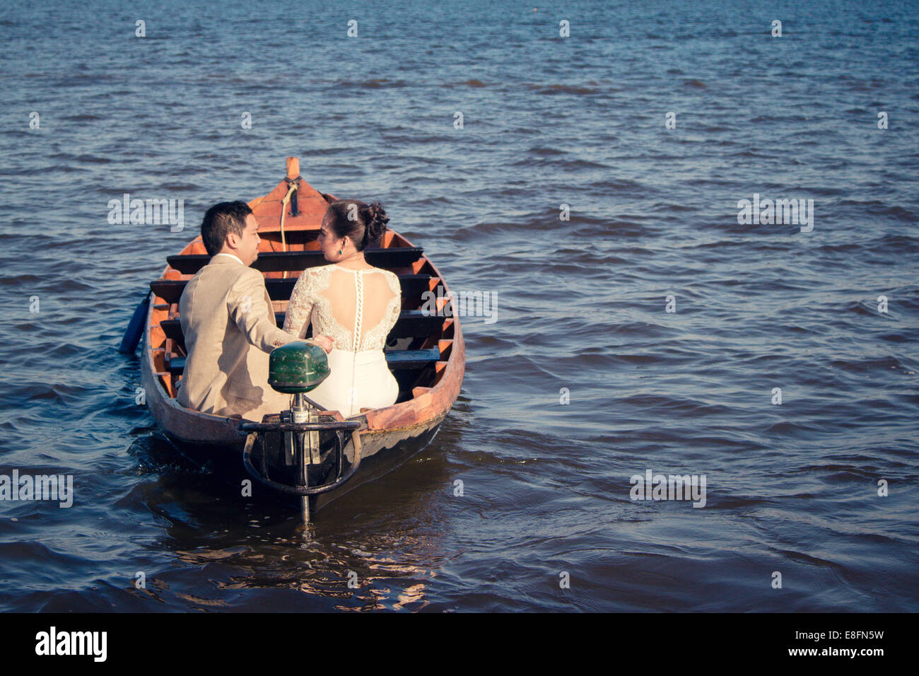 Netherlands, Rear view of couple during boat trip - Stock Image
