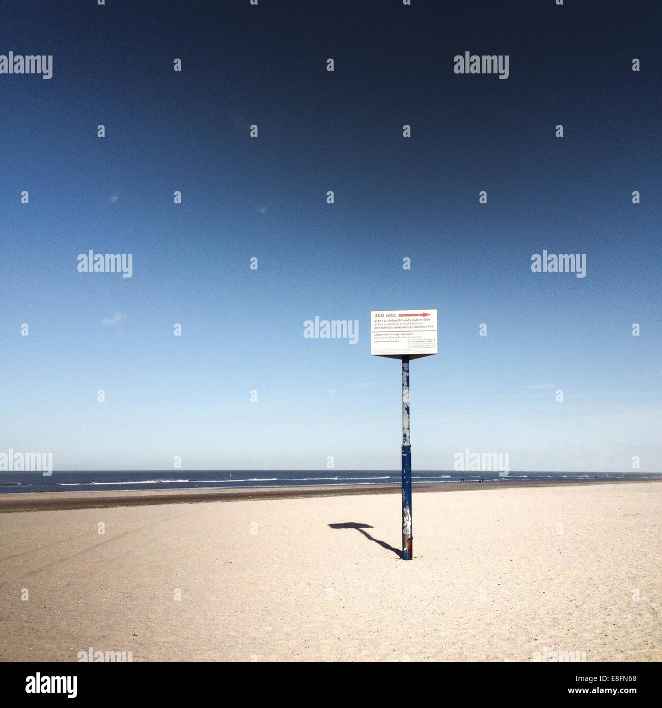 Lonely sign on beach - Stock Image