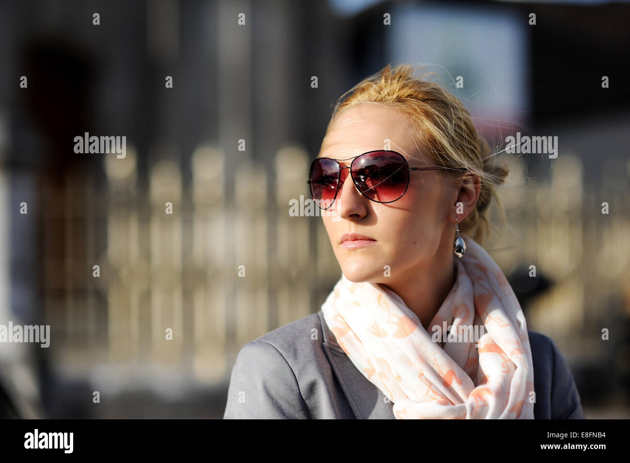 Woman with sunglasses on street in sunny day Stock Photo
